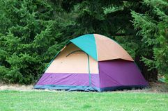 Camping Tent. A tent sits in a forest campground stock photography