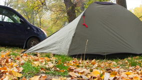 Camping Tent In Autumn Forest. Slider Shot stock video
