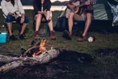 Camping tent camp in nature happy friends group night party bonf. Ire and playing guitar together in summer at nature forest royalty free stock photos