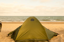 Camping tent and car at seaside daytime waves sea Royalty Free Stock Photography