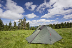 Camping with a tent in the Carpathian Mountains. Camping in the Carpathian Mountains - tent, pasture, mountain and beautiful skies Royalty Free Stock Photography