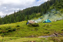 Camping tent at Carpathian mountains, summertime journey, Ukraine, Europe. Camping tent at Carpathian mountains, summertime journey, Ukraine, Europe Royalty Free Stock Images