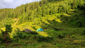 Camping tent at Carpathian mountains, summertime journey, Ukraine, Europe. Camping tent at Carpathian mountains, summertime journey, Ukraine, Europe Royalty Free Stock Photos