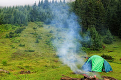 Camping tent at Carpathian mountains, summertime journey, Ukraine, Europe. Camping tent at Carpathian mountains, summertime journey, Ukraine, Europe Royalty Free Stock Image