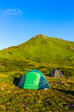 Camping tent in Carpathian mountains, sunrise morning time, summertime journey. Camping tent in Carpathian mountains, sunrise morning time, summertime journey Royalty Free Stock Photos