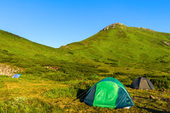 Camping tent in Carpathian mountains, sunrise morning time, summertime journey. Camping tent in Carpathian mountains, sunrise morning time, summertime journey Stock Photography