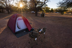 Camping with tent, chairs and camping gear Royalty Free Stock Photography