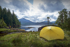 Camping tent on coastline of Alaska. Yellow camping tent on coastline of Ketchican, Alaska, Canada Stock Images