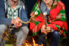Camping. Tent camping couple romantic sitting by bonfire night countryside stock photo