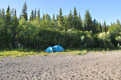 Camping tent at the edge of forest. Stock Photo