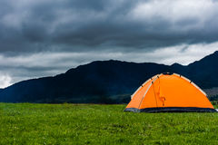 Camping tent in the field Stock Photography