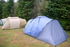 Camping tent field over green grass Royalty Free Stock Image
