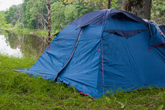Camping tent. In the forest by the river Royalty Free Stock Photos