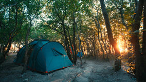 Camping tent in forest with sunlight. Traveling Destination Camping Concept Royalty Free Stock Photography