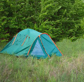 Camping tent in the forest Stock Images