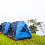 Camping with tent on the grass Royalty Free Stock Image