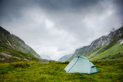 Camping tent high in the mountains Royalty Free Stock Photos