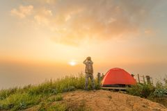 Camping tent on the hill with sunrise or sunset. Background Stock Photography