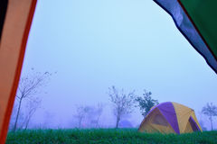 Camping Tent. On hill under raining and mist Stock Photography