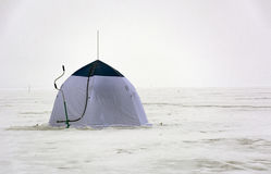 Camping tent, ice screws when ice fishing, snow, winter, sea, Gu Stock Photography