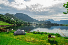 Camping tent by lake Stock Photos