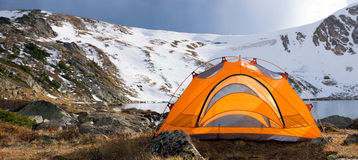 Camping Tent by the Lake in Colorado Royalty Free Stock Images
