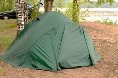 Camping tent on the lake. In Karelia Stock Photos