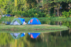 Camping tent on a lake with reflections Stock Photo