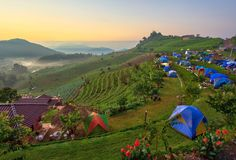 Camping tent with misty sunrise royalty free stock images