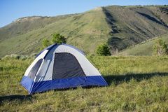 Camping Tent in the mountains. A single tent at the top of the mountains. Camping with a beautiful view stock photos
