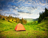 Camping Tent in mountains. Tourist orange tent in mountains in Kazakhstan Royalty Free Stock Photos