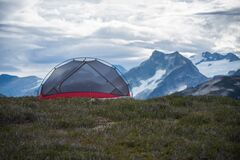 Camping tent in mountains stock images