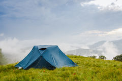 Camping in tent in the mountains Royalty Free Stock Photo