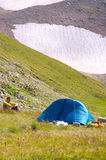 Camping Tent in Mountains with Man Hiker Royalty Free Stock Photos