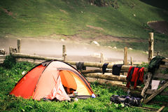 Camping tent near a village in the misty mountains of the Caucas Stock Images