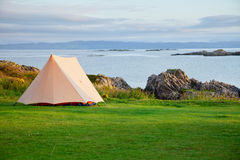 Camping tent on ocean shore Stock Photography