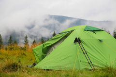 Camping tent outdoor in the nature forest with mist Stock Image