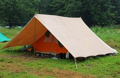 Camping tent in a scout camp on the lawn Stock Photography
