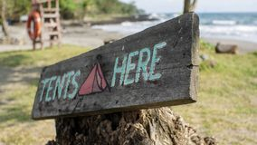 Camping tent sign by the beach royalty free stock photos