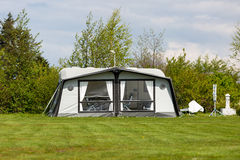 Camping tent. On camping site. Trademarks have been removed royalty free stock images