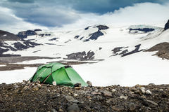 Camping with tent. Snowy mountain glaciers and storm wind. Iceland Royalty Free Stock Photo