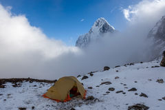 Camping tent in snowy mountains. Royalty Free Stock Images