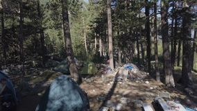 Camping tent in summer forest while traveling and hiking wild nature drone view. Camping tent in summer forest while traveling and hiking to wild nature. Drone stock video footage