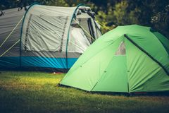 Camping in a Tent. Summer Vacation Camping in a Tent. Campsite with Two Large Tents stock image