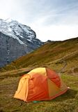 Camping tent in swiss alps Stock Photos