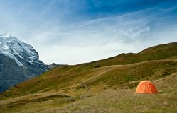Camping tent in swiss alps Royalty Free Stock Photos