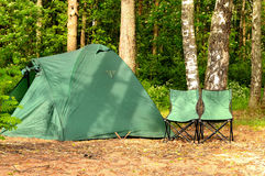 Camping tent and two chairs. In the forest Royalty Free Stock Images