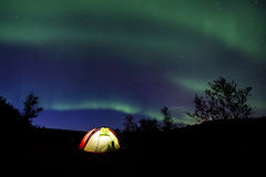 Camping. Tent under northern lights at night stock photos