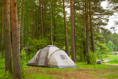 Camping tent in wooded campsite. Hamina, Finland, Suomi. HAMINA, FINLAND - JUNE 13, 2014: Summer outdoor recreation, Scandinavian vacation. Camping tent in a Royalty Free Stock Photos