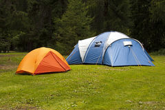 Camping tents. In a green grass Stock Image